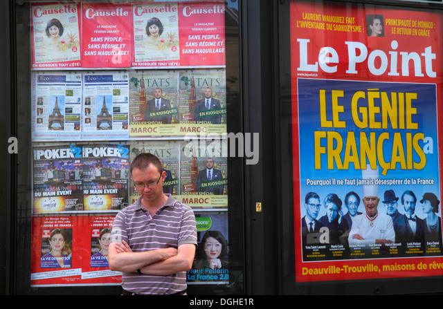 Paris France Europe French 18th arrondissement Place Jules Joffrin billboard advertising Le Point magazine man - Stock Image