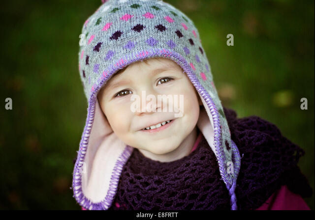 Portrait of young girl wearing hat - Stock Image