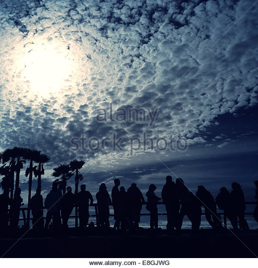 Crowd of people by railing - Stock Image