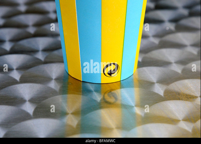Recycling symbol on paper cup, London - Stock Image