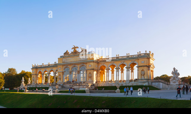 Gloriette Schonbrunn at sunset with tourists in Vienna - Stock Image