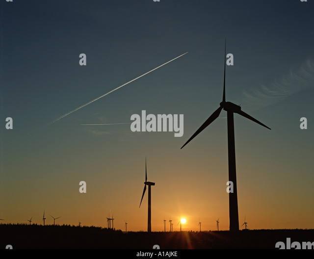 Wind farm at sunset - Stock Image