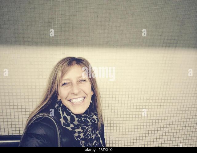 London, UK Smiling Woman Portrait - Stock Image