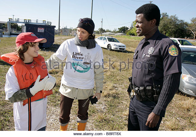 Miami Florida Oakland Grove Annual Little River Day Clean Up trash pick up litter clean pollution volunteer student - Stock Image