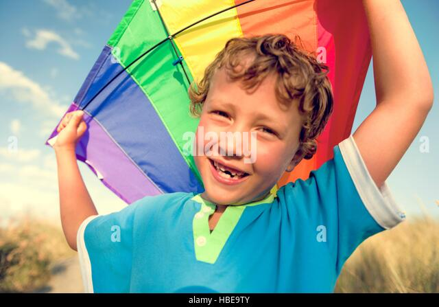 Kite Boy Brother Happiness Joyful Holiday Child Concept - Stock Image