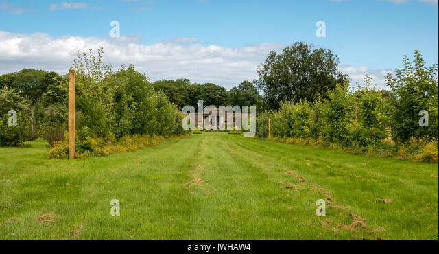 Garden view grass path stock photos garden view grass for Garden design east lothian