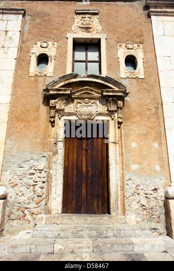 Door of Santa Caterina church Taormina, Sicily, Italy - Stock Image