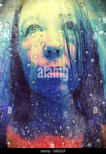 Portrait of a woman with wet hair and water droplets - Stock Image