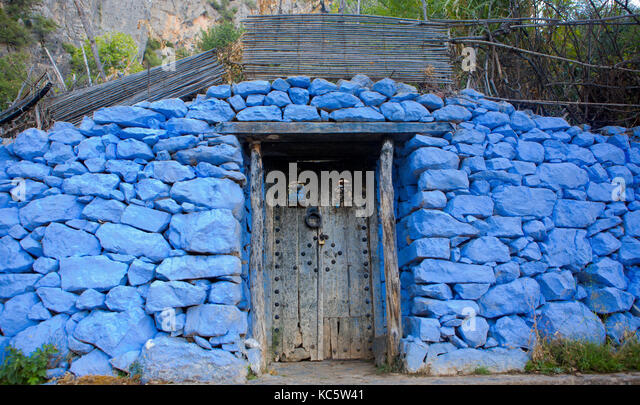 Traditional powder blue painted house facade and door in the historical Medina of Chefchaouen, Morocco - Stock Image