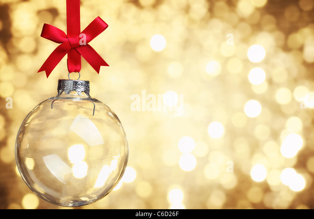 Closeup of glass Christmas ball on abstract light background. - Stock Image