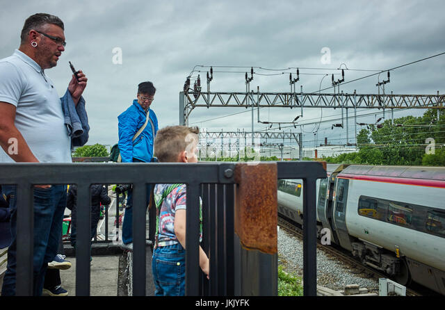 People watching Virgin trains Pendalino at Crewe Railway heritage centre - Stock Image