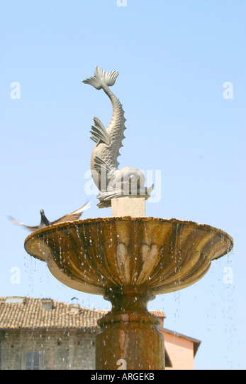 One of the twin delicate dolphin fountains in the beautiful city of Ascoli Piceno, Le Marche, Italy - Stock Image