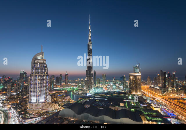 Burj Khalifa , the Dubai Mall and skyline of Downtown Dubai at night in United Arab Emirates - Stock Image