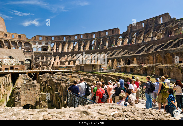 Rome, Italy. Tourists sightseeing at the Colosseum begun by Emperor Vespasian in 72 AD. - Stock Image