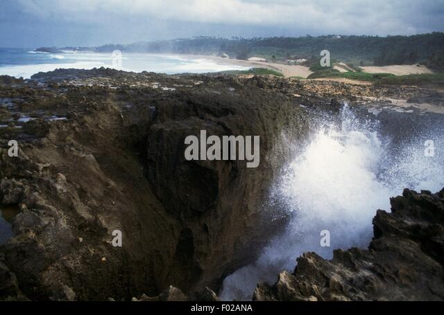 Waves breaking on the north rocky coast of Quebradillas, Puerto Rico. - Stock Image