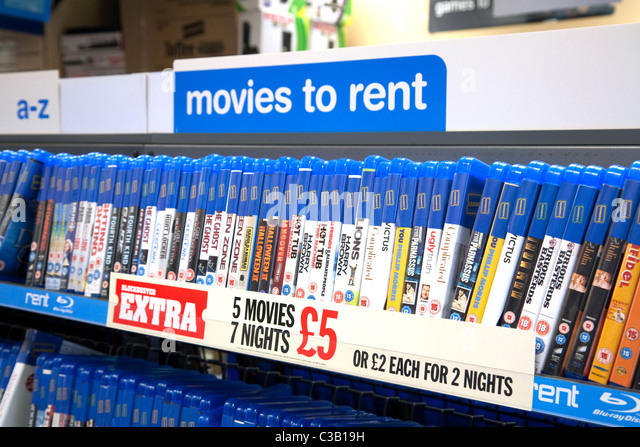 Shelves of DVD DVDs films to rent, Blockbuster Video, Wallingford Oxfordshire - Stock Image