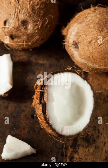 Fresh Organic Brown Coconut with White Flesh - Stock Image