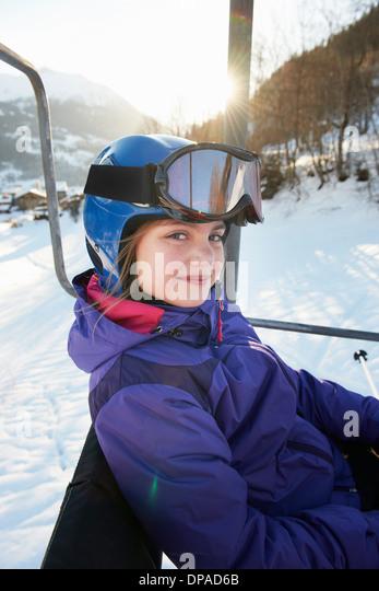 Young girl on ski lift, Villaroger, Haute-Savoie, France - Stock Image