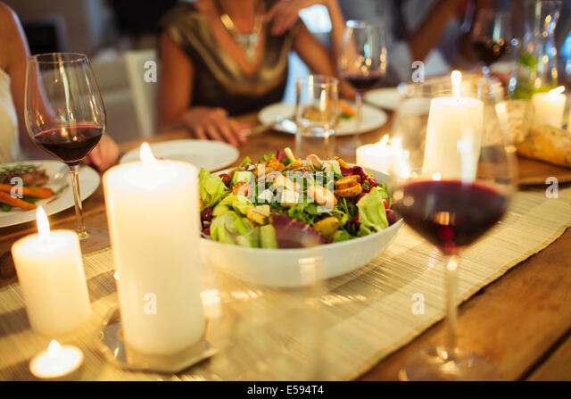 Salad bowl on table at dinner party - Stock Image
