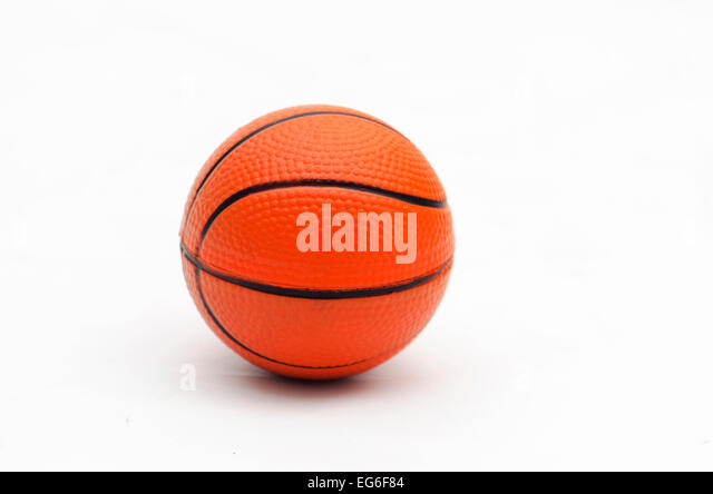 orange basket ball on white background - Stock Image