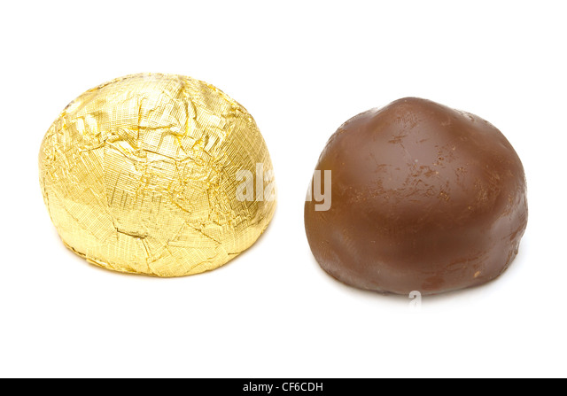Chocolate pralines on white background - Stock Image