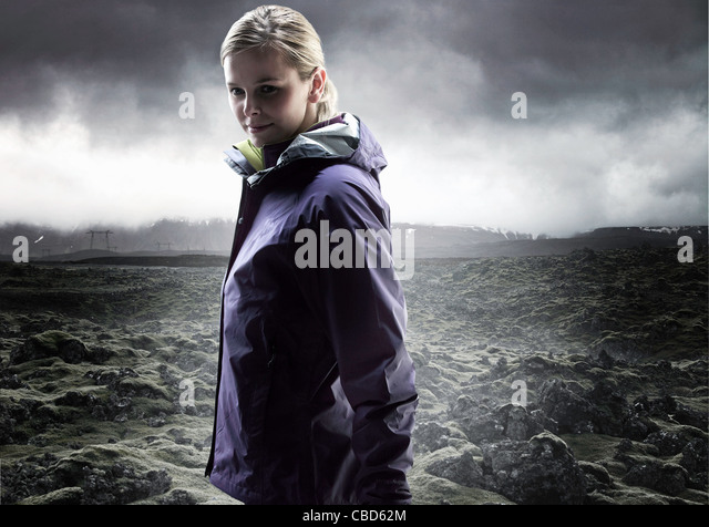 Woman walking in rocky landscape - Stock Image