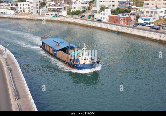 Commercial boat on Tongyeong Canal, South Korea - Stock Image