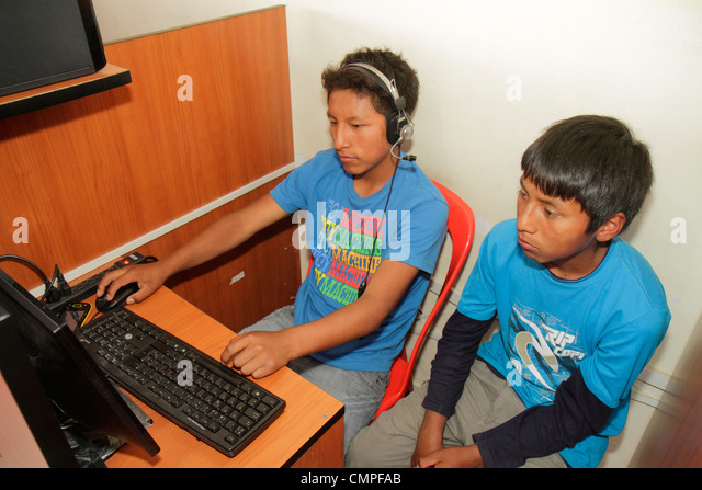 Peru Tacna Avenida San Martin Internet cafe cybercafé business technology online access computer keyboard headphone - Stock Image