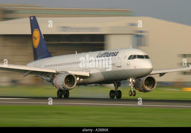 Lufthansa Airbus A320 landing at London Heathrow Airport - Stock Image