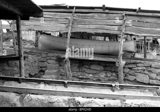 Escalo Formentera boat stranded wooden rails Balearic Islands - Stock Image