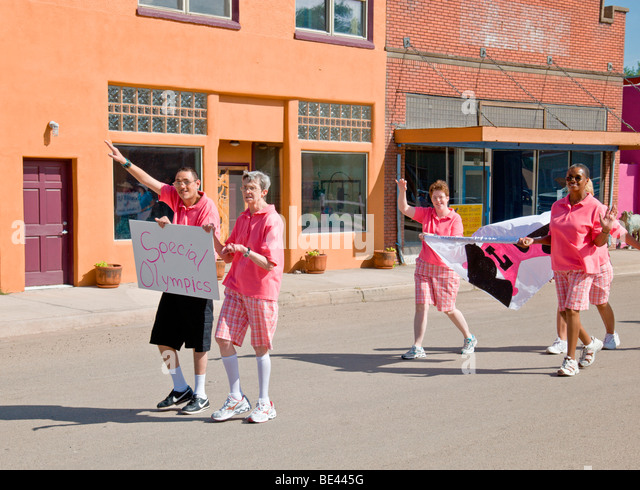 The participants in Special Olympics march by at the Street Festival in Carrizozo, New Mexico. - Stock Image