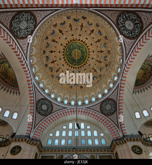 Decorated ceiling of Suleymaniye Mosque with main dome and intersection of three arches, Istanbul, Turkey - Stock Image