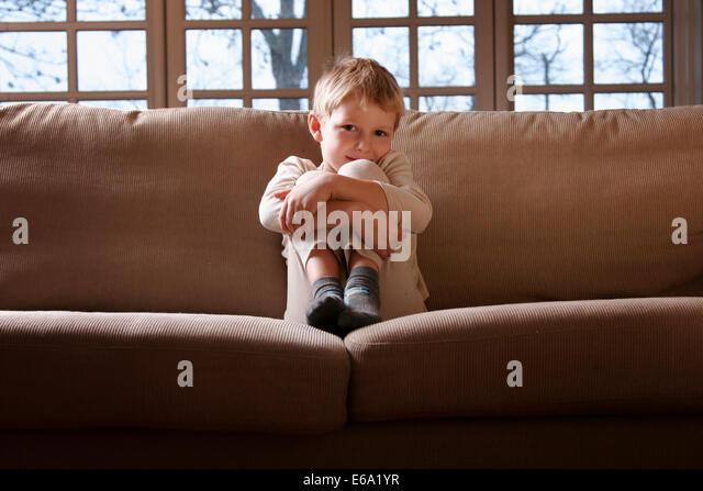boy,domestic life,sofa - Stock Image