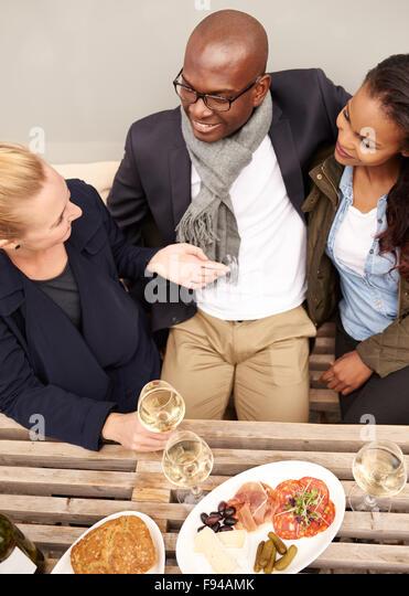 Group of friends having dinner outside, multi ethnic group - Stock-Bilder