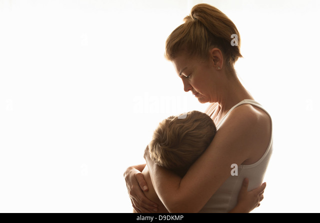 Mother hugging son - Stock Image