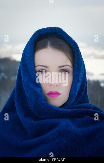 Portrait Of Beautiful Woman Covered With Head Scarf Outdoors - Stock Image