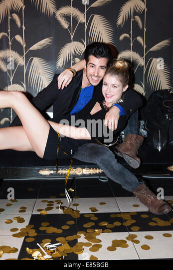 Couple embracing at party, portrait - Stock-Bilder