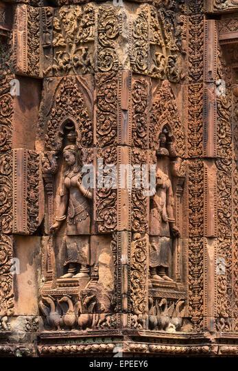 Devi sandstone figures, Mandapa, Khmer Hindu temple Banteay Srei, Siem Reap Province, Cambodia - Stock Image