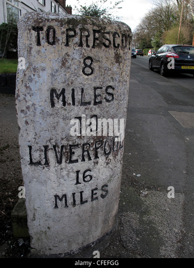 Milepost To Prescot 8 Miles, Liverpool 16 Miles on A57 at Liverpool Road, Penketh, Cheshire, England UK - Stock Image