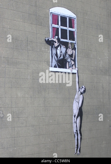 An art work by Banksy, at the bottom of Park Street, in central Bristol, England. The Council have decided not to - Stock Image