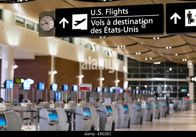 U.S. Flights sign in an airport terminal, James Armstrong Richardson International Airport, Winnipeg, Manitoba, - Stock Image
