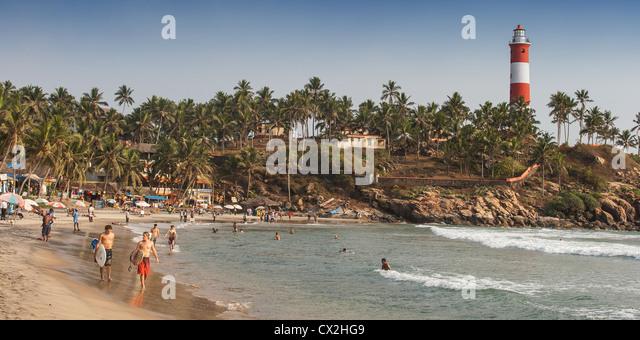 Kovallam beach,Surfer, lighthouse, India Kerala - Stock Image