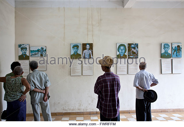 Cambodians watching the photo exhibition. Tuol Sleng Genocide Museum. Phnom Penh. Cambodia - Stock Image