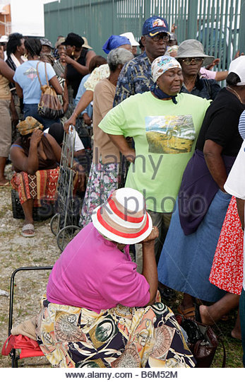 Miami Florida Little Haiti Thanksgiving Turkey Give-Away give away volunteers Haitian Black woman women senior assistance - Stock Image