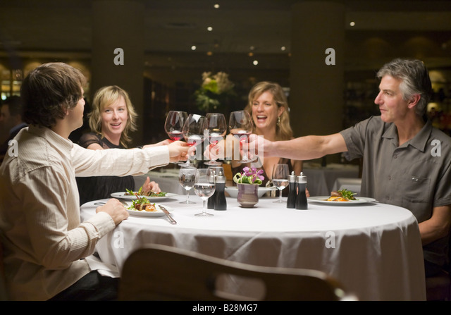 middle aged group enjoying a fine dinning experience Whistler Village British Columbia Canada - Stock Image