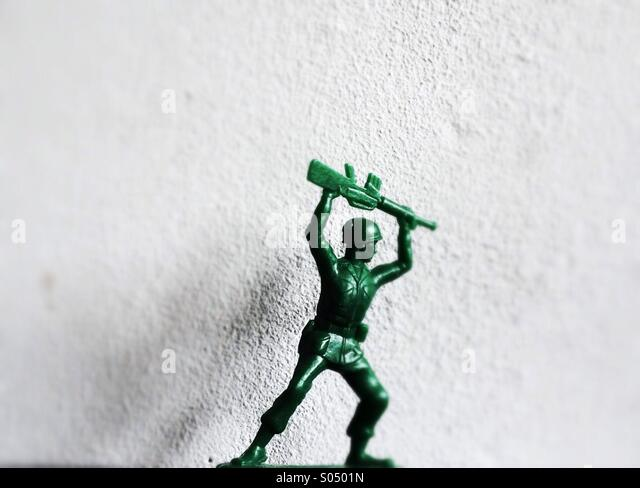 Plastic green toy soldier - Stock Image