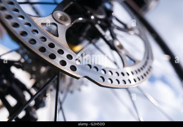 steel metal disc brake on road bike giving great sharp breaking stopping ability but knife sharp edges risk of cuts - Stock-Bilder