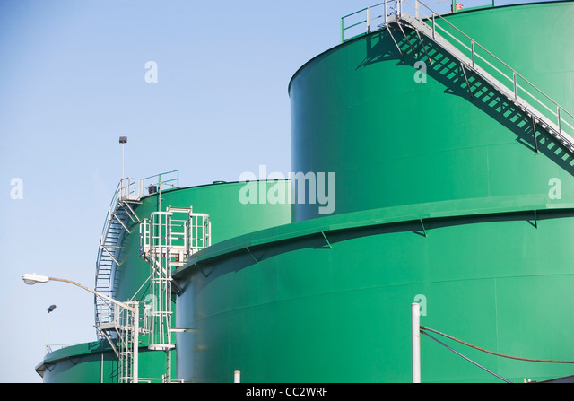 USA, New York City, Green storage tanks - Stock Image