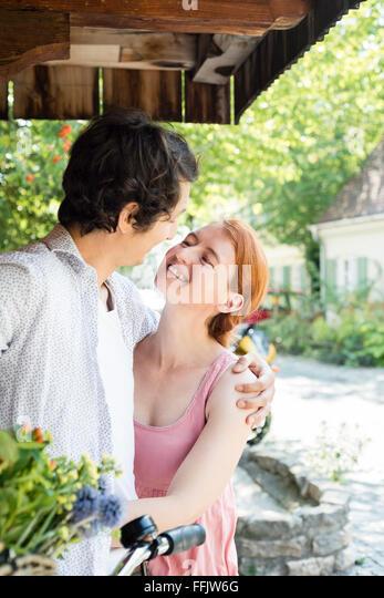 Portrait of happy couple embracing - Stock Image