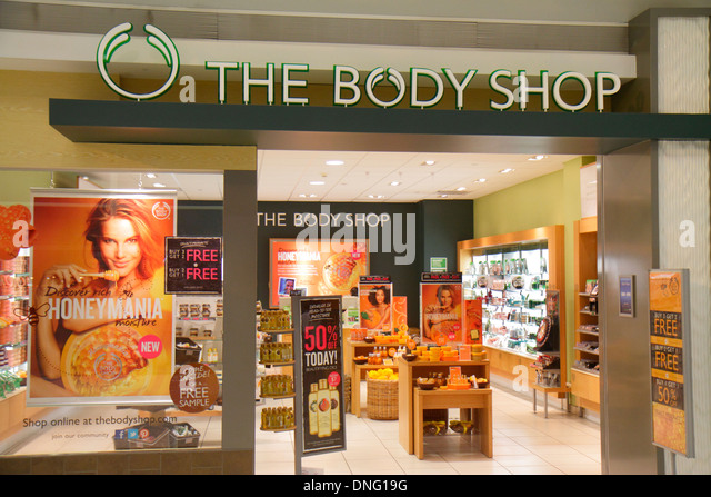 New Jersey Newark Newark Liberty International Airport EWR terminal concourse gate area shopping The Body Shop skincare - Stock Image
